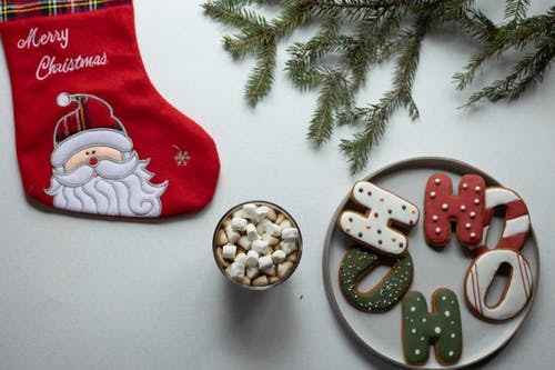 Christmas decor with biscuits and hot drink with marshmallows