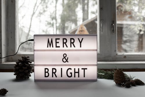 Merry and Bright title on electric signboard on windowsill