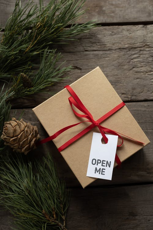 Gift cardboard box with Open Me title on tag