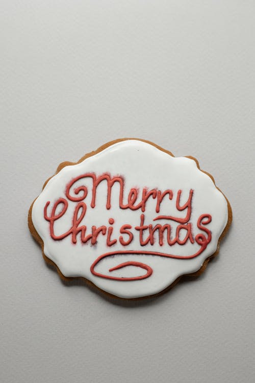 Greeting inscription on gingerbread cookie