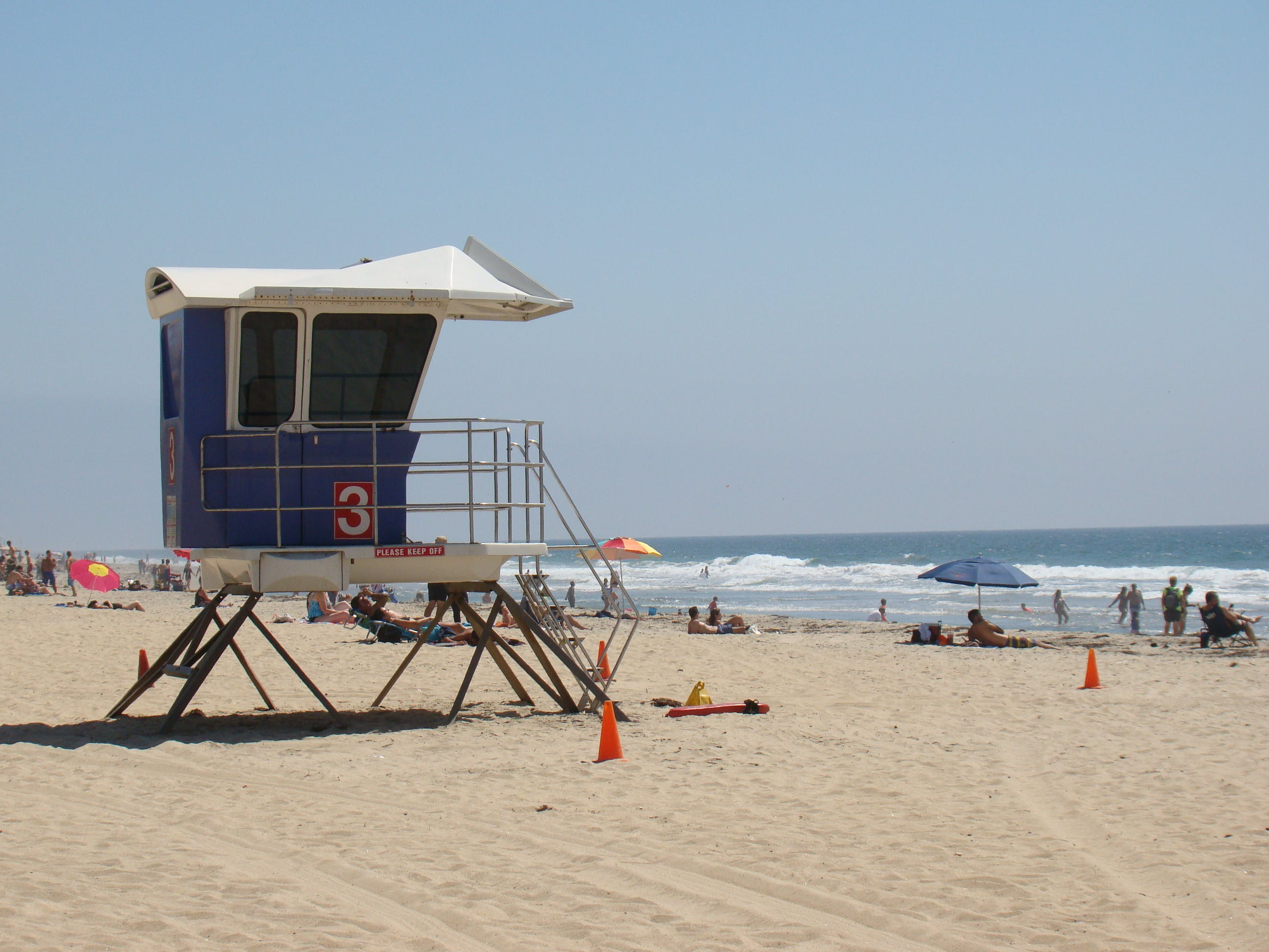 Blue and Gray Guardhouse on Beach