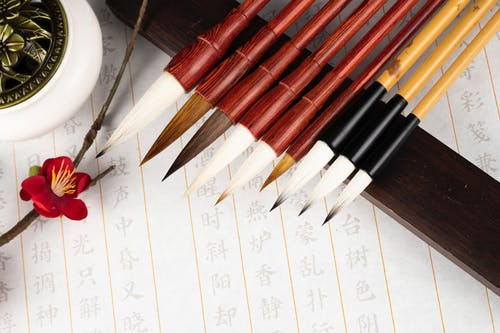Collection of calligraphy brushes on paper with hieroglyphs
