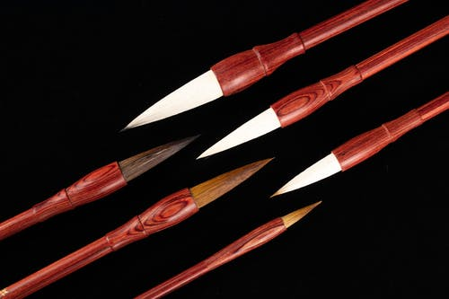 Various calligraphy brush pens on black background