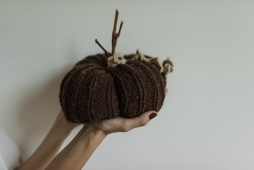 Person Holding a Knitted Handicraft