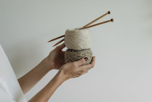 Person Holding Knitting Threads