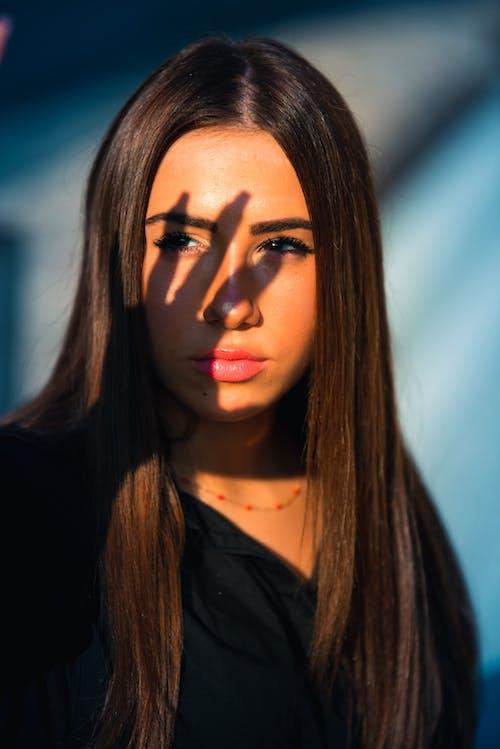 Woman in Black Shirt With Black Eyeshadow