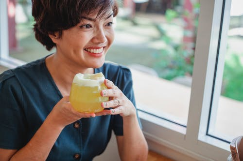 Happy Asian woman with cocktail