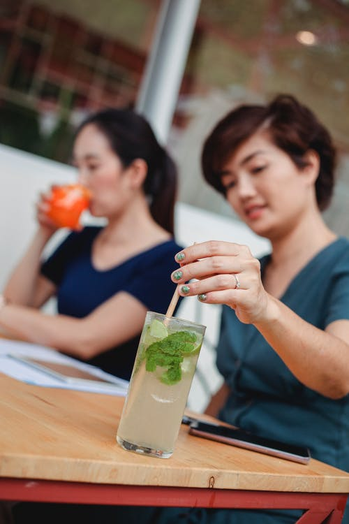 Asian women drinking cocktails during work