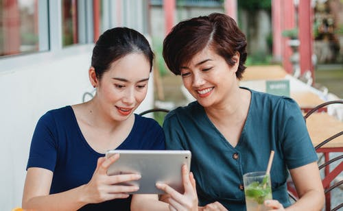 Happy Asian women watching video on tablet