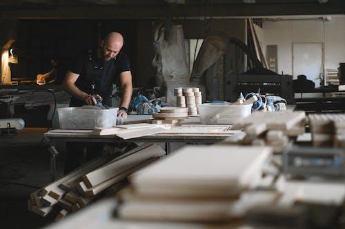 Focused craftsman working with wood