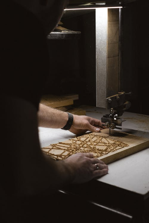 Crop craftsman making patterns on wooden board