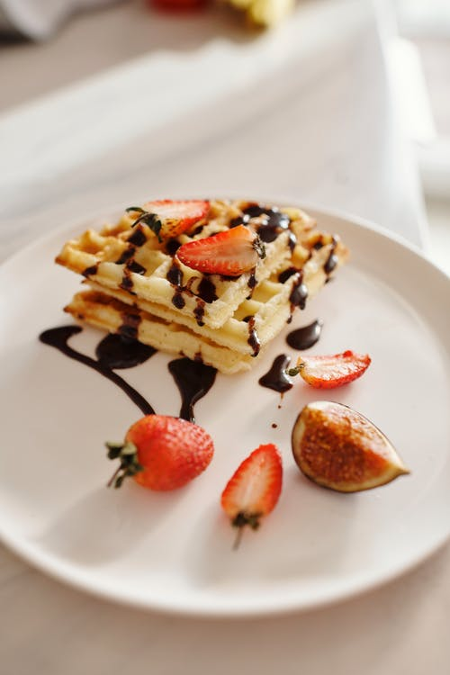 Strawberry and Chocolate Ice Cream on White Ceramic Plate