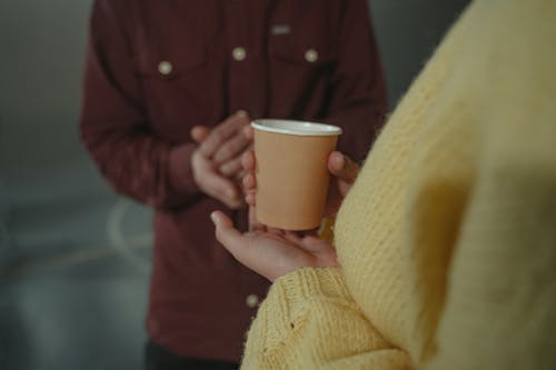 Person in Yellow Knit Sweater Holding White Ceramic Mug