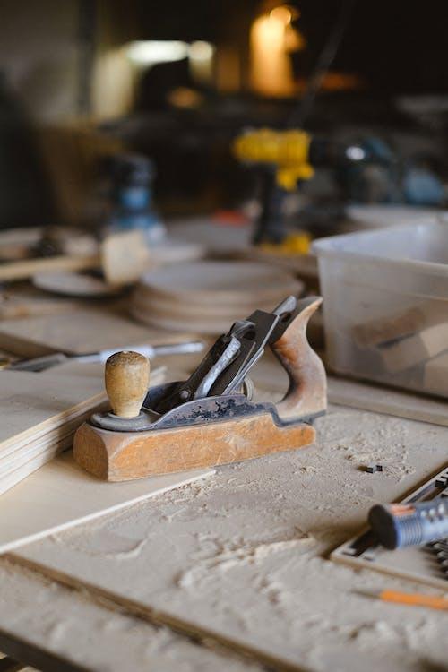 Wooden plank on workbench in workshop
