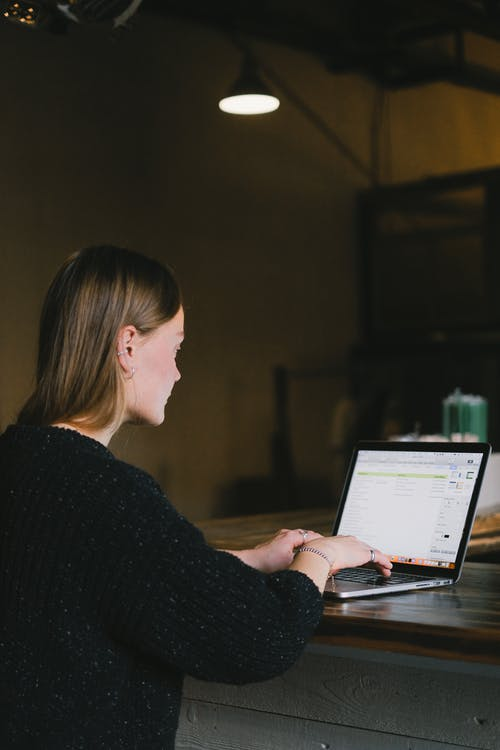 Focused woman typing on laptop