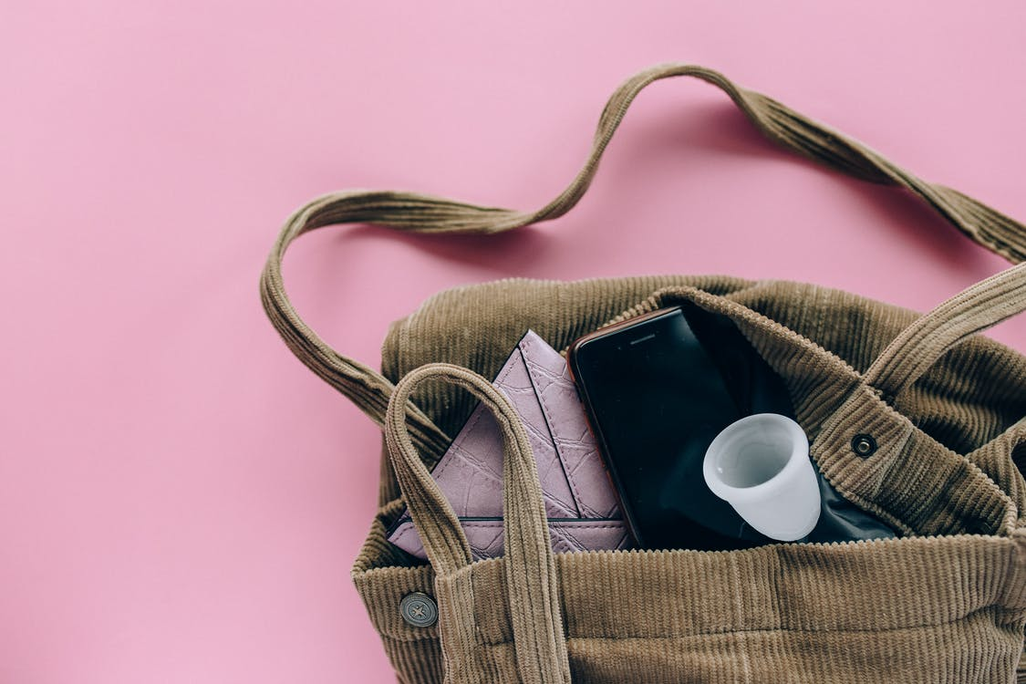 Silver Iphone 6 on Brown Woven Bag