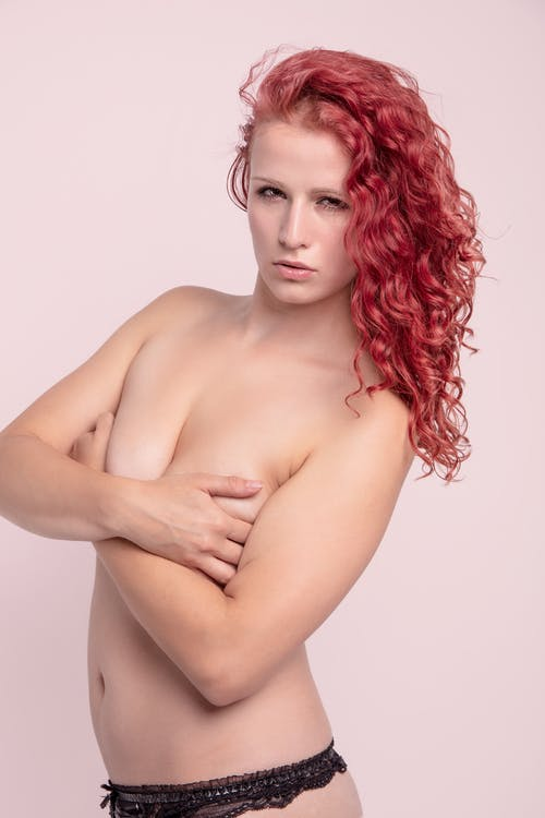 Topless Woman With Red Hair Posing in Underwear