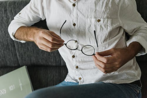 Man in white shirt and jeans with eyeglasses