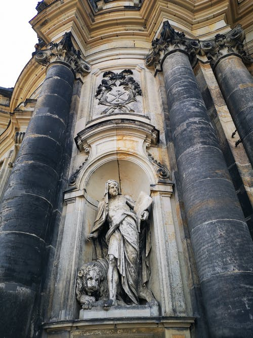 Statue of Man in the Wall of Cathedral