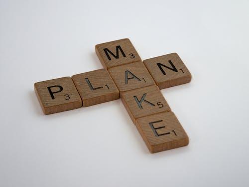 Scrabble Tiles on a White Table