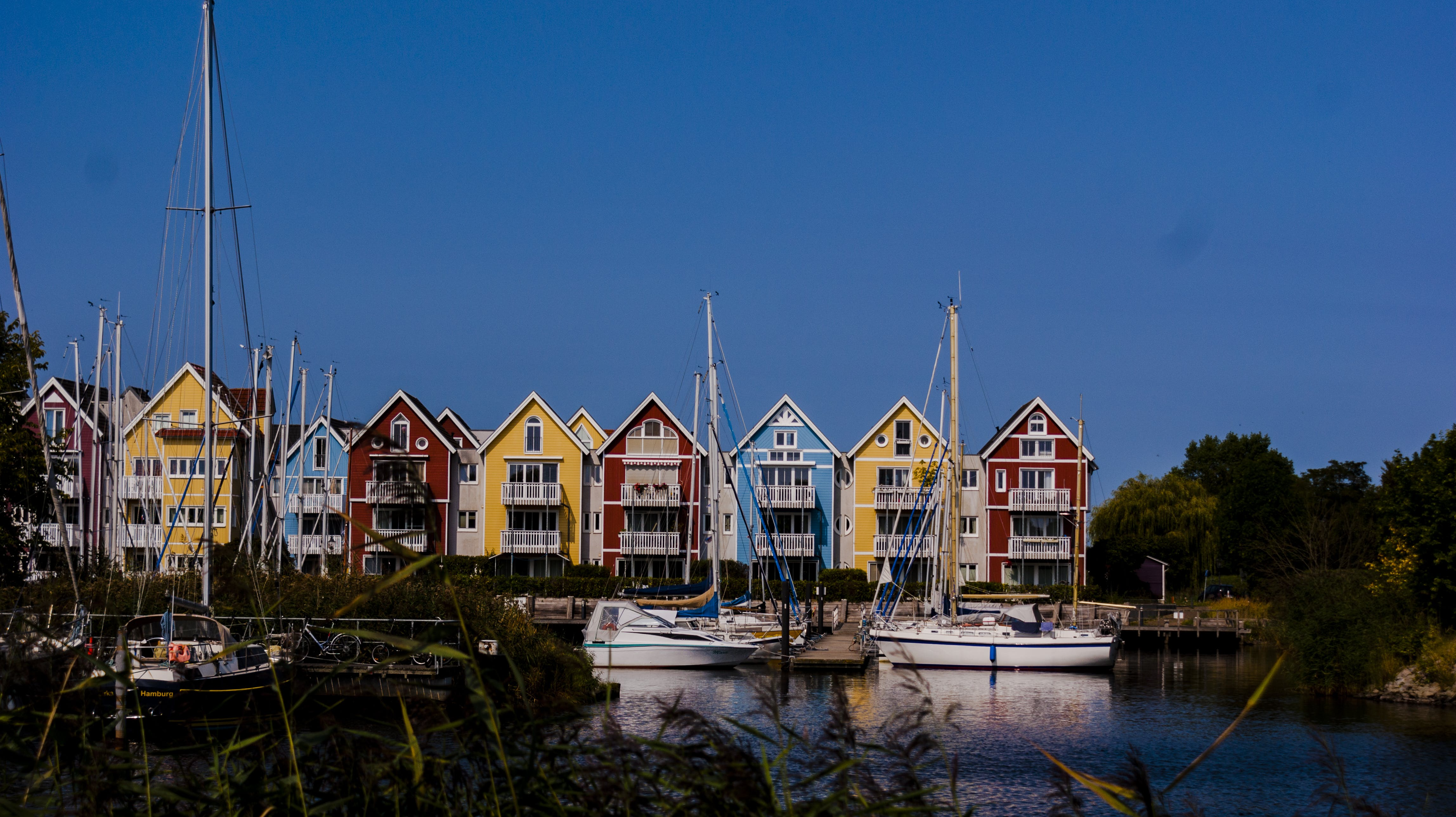 Free stock photo of boats, colorful houses, houses, nautical