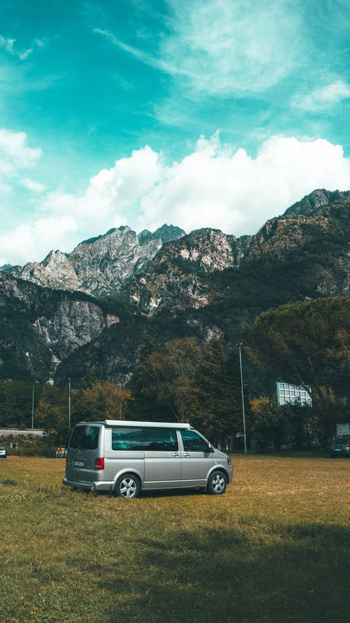 Van Parked on the Grass Near the Mountain