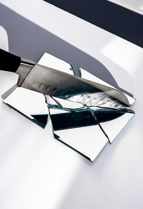 Broken Mirror Smashed by a Knife