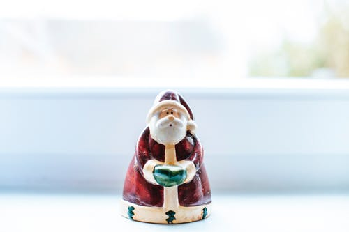 Santa Claus Ceramic Figurine on White Table