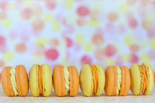 Yellow and Pink Cookies on White Ceramic Plate