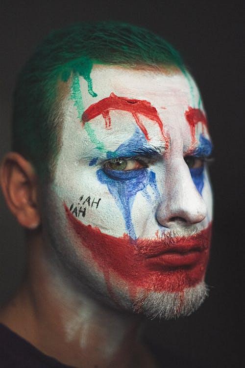 Man wearing Halloween makeup of clown