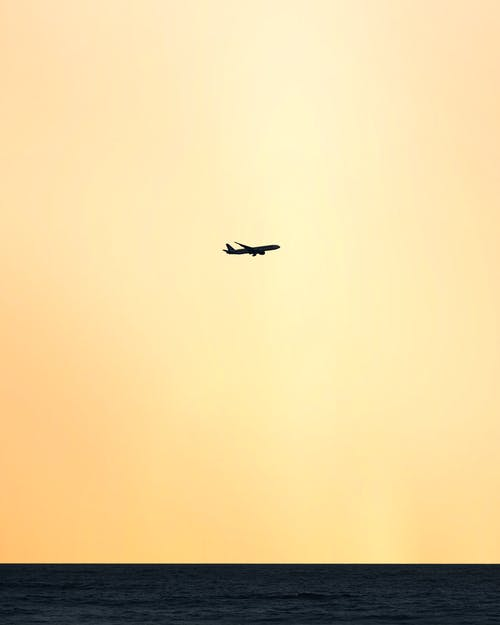 Silhouette of Airplane in Sunset Sky