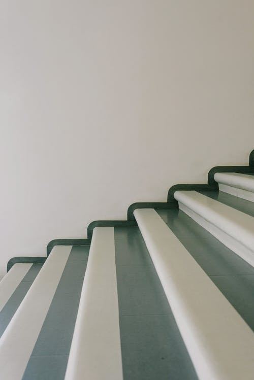 Stairway with striped stairs in residential building