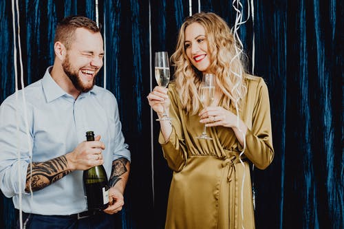Man and Woman Having Fun Drinking Champagne