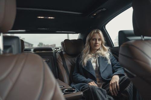 Woman in Gray Cardigan Sitting on Car Seat