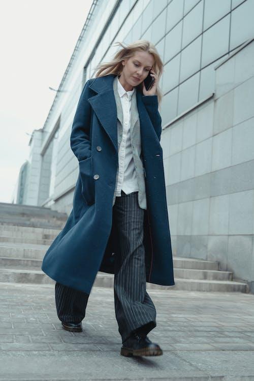 Woman in Blue Blazer and Black Pants Standing on Sidewalk
