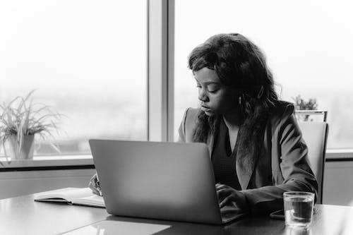 Woman in Black Jacket Using Macbook