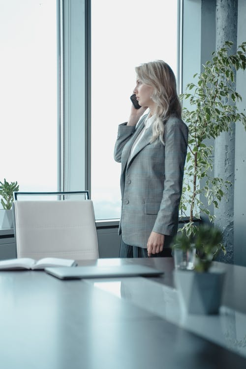 Woman In Gray Blazer On The Phone