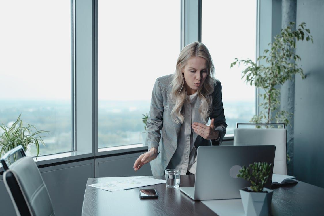 Woman in Gray Blazer Having a Video Conferencing