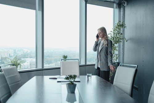 Woman In A Gray Blazer Talking On The Phone