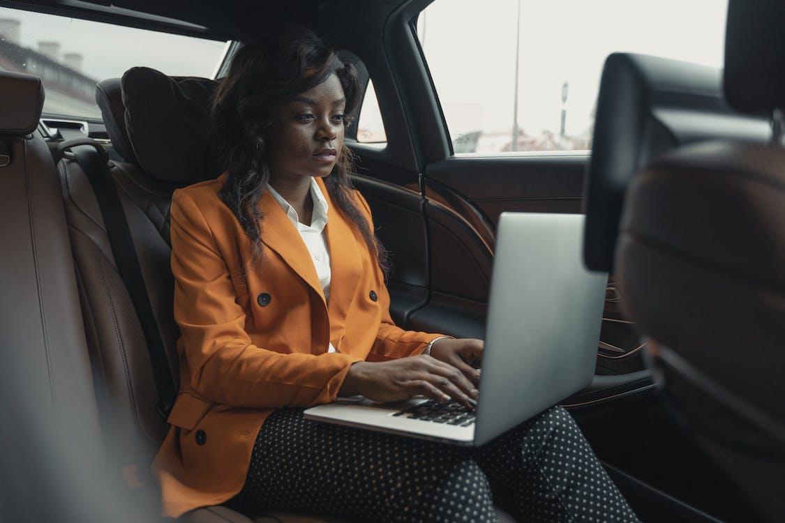 Woman Wearing A Blazer Sitting Inside The Car