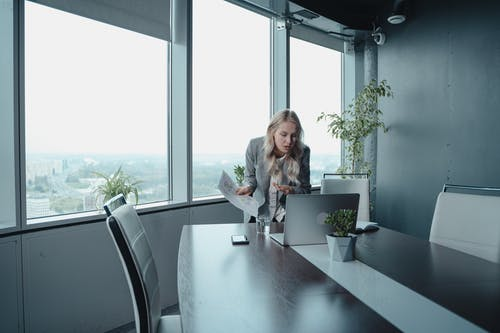 Woman In Gray Blazer In A Video Meeting