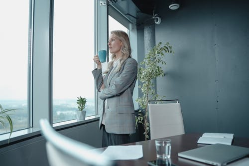 Woman In Gray Blazer Holding Ceramic Mug