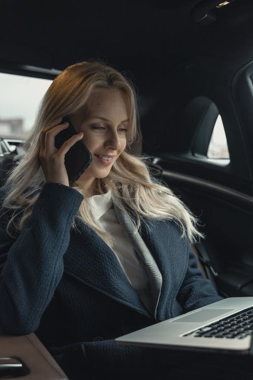 Woman In Gray Blazer Sitting Inside Car