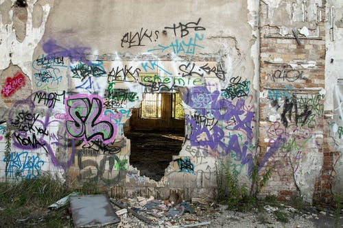 Vandalism on the Abandoned Building Wall