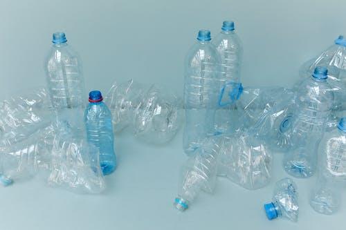 Clear Plastic Bottles on White Table