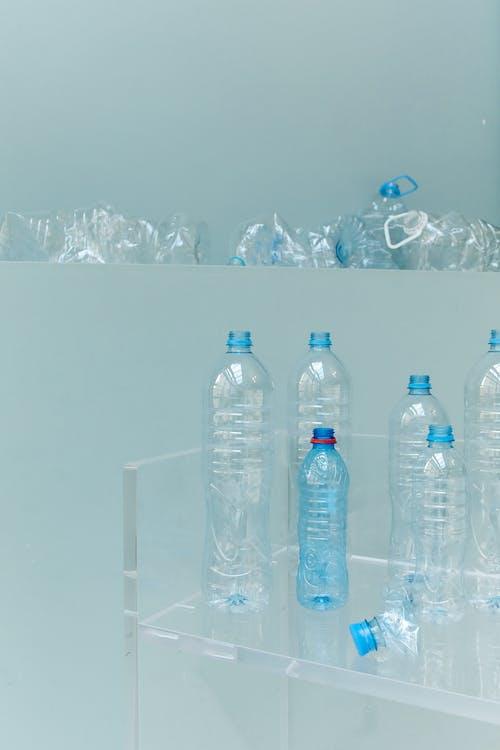 Clear Plastic Bottle on Glass Shelf