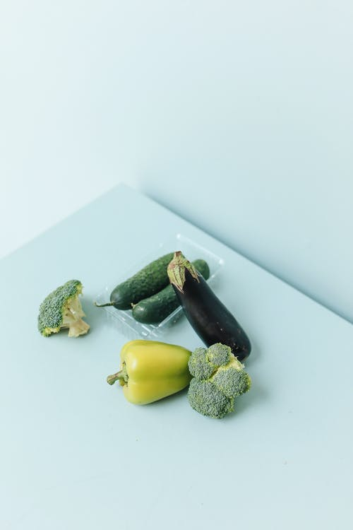 Close-Up Shot of Fresh Vegetables on a White Surface