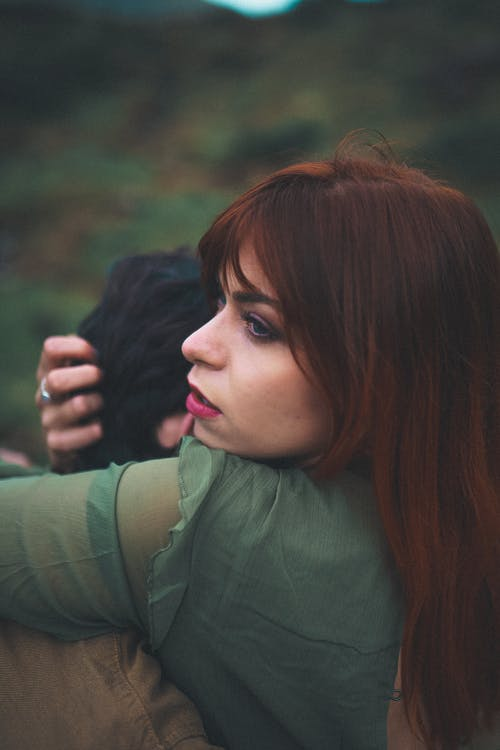 Young romantic couple hugging in nature