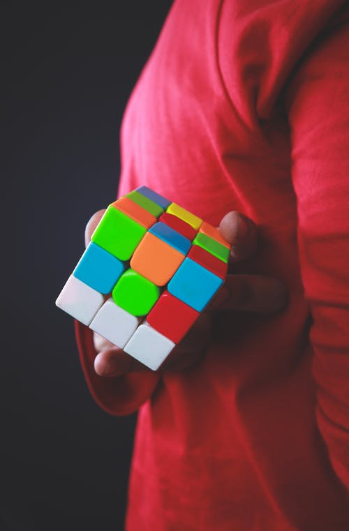 Close-Up Shot of a Person Holding a Rubik's Cube