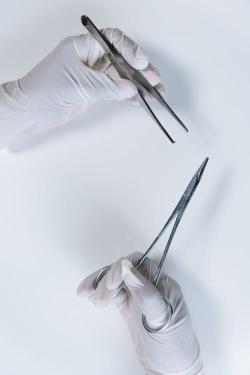 Close-Up Shot of a Person Holding Forceps